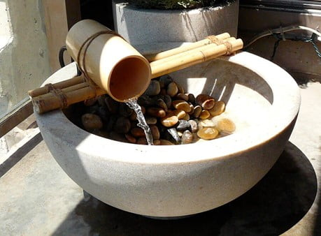 Basin with Pebbles and A Bamboo Faucet